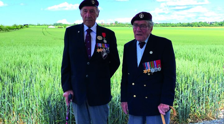 Allan (left) at the landing zone 75 years on with Bill Gladden (Right)